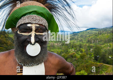 Colorfully dressed and painted local tribal chief in the Highlands of Papua New Guinea, Melanesia - Stock Photo