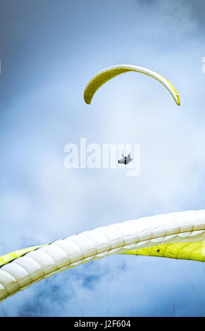 Paragliding in clouds - Stock Photo