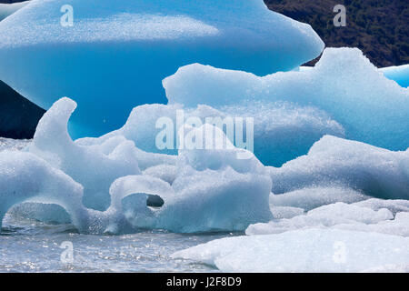 Ice from a glacier in the lake Lago Grey in Torres del Paine National Park - Stock Photo