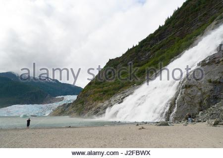 Nugget Creek waterfall cascading into Mendenhall Lake, Tongass National Forest, Juneau Borough, Alaska, USA - Stock Photo