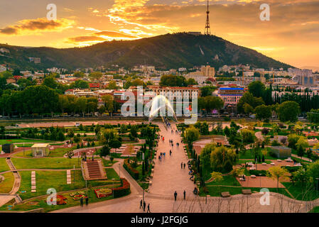 View of Rike Park with Bridge of Peace at sunset. Center of Tbilisi city, Georgia - Stock Photo