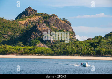 Little motorboat cruising before, Naviti island, Yasawa, Fiji, South Pacific - Stock Photo