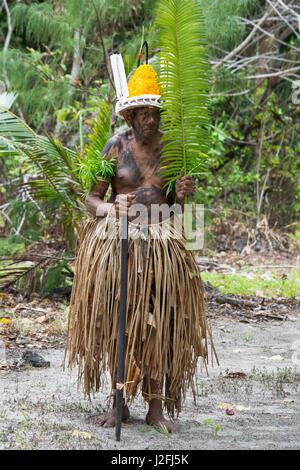 Republic of Vanuatu, Torres Islands, Loh Island. Village elder dressed in traditional palm leaf attire for 'The - Stock Photo