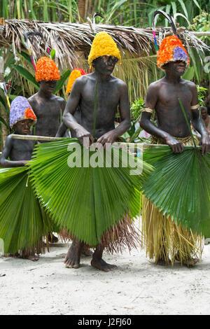 Republic of Vanuatu, Torres Islands, Loh Island. Ceremonial dance in the rain with costumed boys in colorful headdresses - Stock Photo