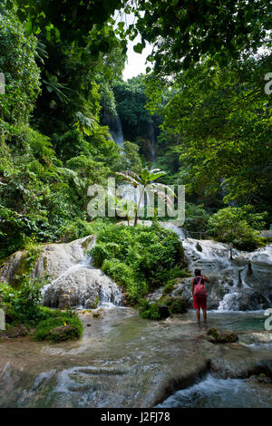Woman looking at the beautiful Mele-Maat cascades in Port Vila, Island of Efate, Vanuatu, South Pacific (MR) - Stock Photo