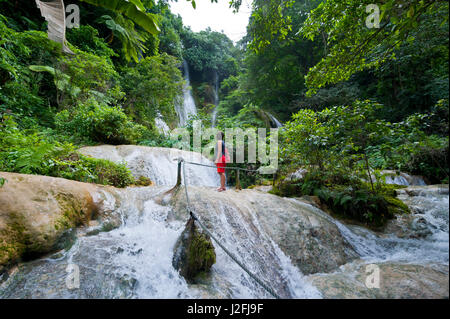 Woman looking at the beautiful Mele-Maat cascades in Port Vila, Efate Island, Vanuatu, South Pacific. (MR) - Stock Photo
