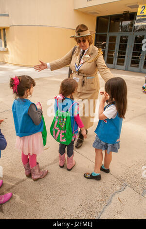 A woman in a historic uniform portrays Girl Scouts founder 'Miss Daisy' Juliette Gordon Law greets Daisy scouts - Stock Photo