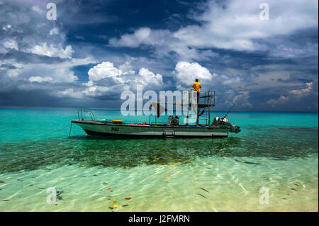 Little motorboat in the turquoise waters of the Ant Atoll, Pohnpei, Micronesia - Stock Photo