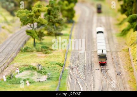 model freight wagons on a miniature train set - shallow d.o.f - Stock Photo