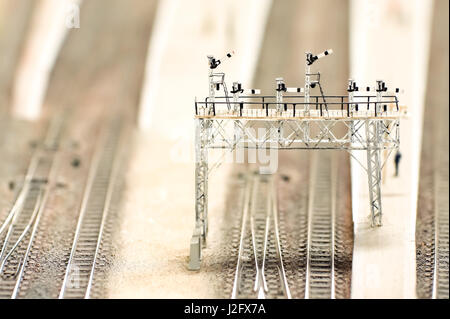 miniture railway overhead signal gantry with shallow d.o.f - Stock Photo