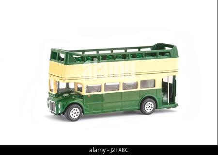 miniature scale model of a vintage open-top tour bus on white - Stock Photo