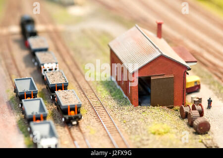 building and freight wagons on a miniature train set - shallow d.o.f - Stock Photo
