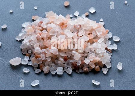 Himalayan salt on the blackboard. - Stock Photo