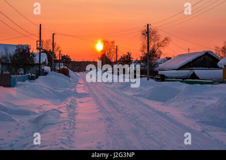 Winter landscape. Winter sunset in snowy village - Stock Photo