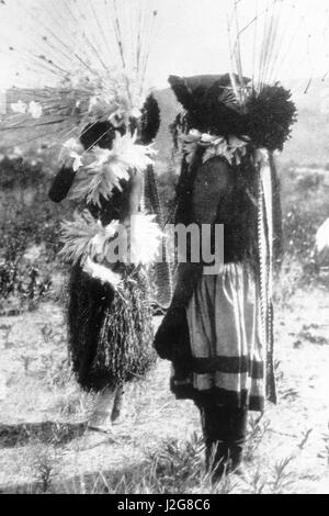 Historic black and white photograph of two Pomo dancers dressed in traditional dance regalia during a Big Head Ceremonial - Stock Photo