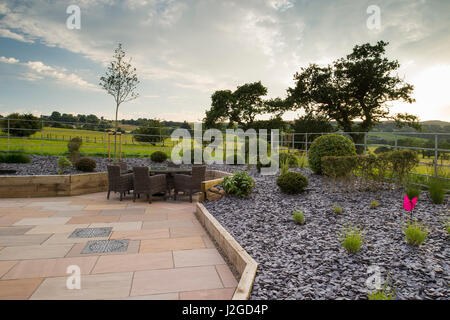 Beautiful, private, contemporary landscaped, garden, England, GB, UK - outdoor seating (patio furniture) raised - Stock Photo