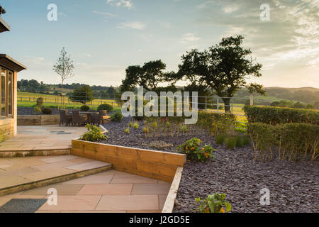 Beautiful, private, contemporary landscaped, garden, England, GB, UK - outdoor seating (patio furniture) paved steps, - Stock Photo