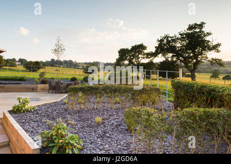 Beautiful, private, contemporary landscaped, garden, England, GB, UK - outdoor seating (patio furniture) paving, - Stock Photo