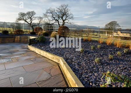 Winter sun on beautiful, private garden, Yorkshire, England, UK - stylish, contemporary design, hard landscaping - Stock Photo