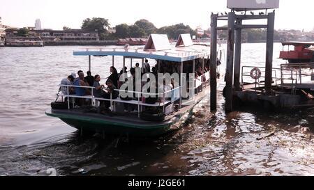 Sathorn Ferry Boat Crossing the Chao Phraya River Bangkok Thailand - Stock Photo