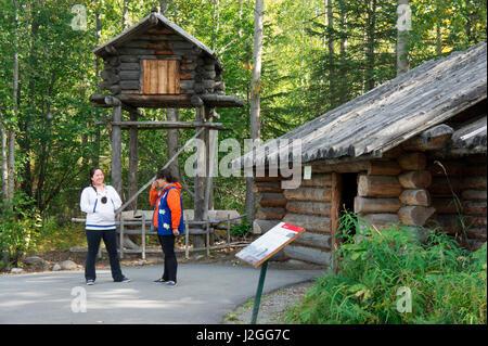 Native interpreters enrich the visitors' experience, Alaska Native Heritage Center, Anchorage, Alaska - Stock Photo