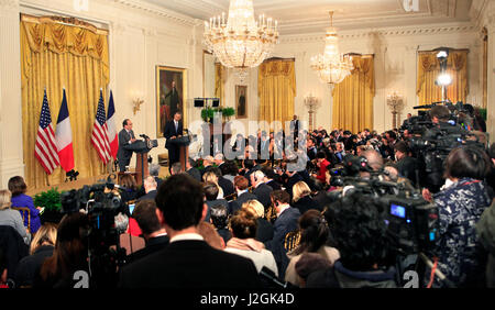 President Barack Obama and President Francois Hollande of France hold a news conference in the East Room of the - Stock Photo