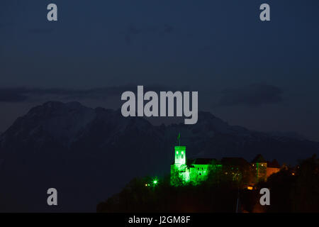 Ljubljana Castle lit up green to celebrate its status as European Green Capital 2016, Slovenia. Seen from the southside - Stock Photo