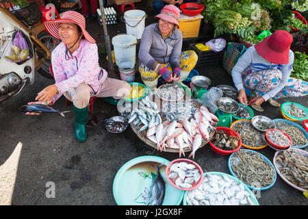 NHA TRANG, VIETNAM - JANUARY 20: Women are selling seafood at the wet market on January 20, 2016 in Nha Trang, Vietnam. - Stock Photo