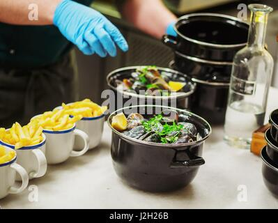 French fries with seafood on stone table. Mussels and prawns. Top view - Stock Photo