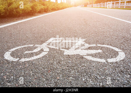 Bicycle sign on the road. Bike lane in the park - Stock Photo