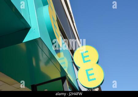 EE mobile phone shop sign outside a shop. - Stock Photo