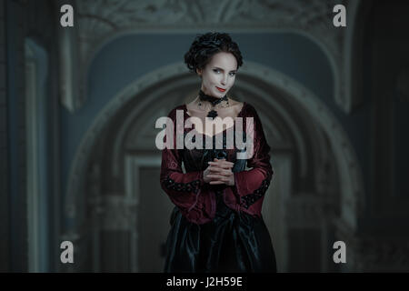 Portrait of a woman with a cunning grin on his face. - Stock Photo