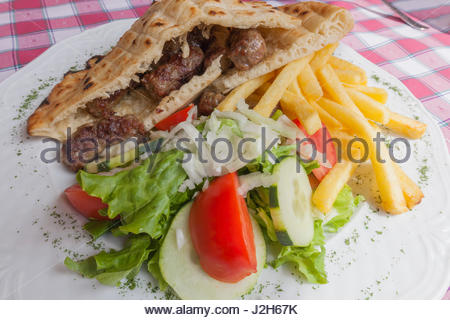Europe, Bosnia and Erzegovina, Medjugorje. Cevapcici and vegetables. Popular food of Balkans - Stock Photo