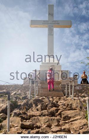 Europe, Balkans, Bosnia and Herzegovina, Medjugorje. Pilgrims praying near the big cross on the Hill Krizevac - Stock Photo