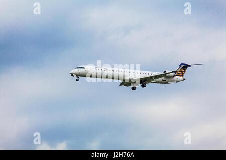 Eurowings Canadair CL-600-2D24 Regional Jet CRJ-900LR - D-ACNW landing, GERMANY,  HAMBURG Airport, September, 08, - Stock Photo