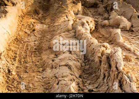 tire marks on dirt in brown tones - Stock Photo