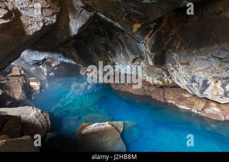 Grjótagjá, small lava cave near lake Mývatn with thermal spring inside, Iceland - Stock Photo