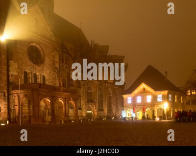Freiburg, Germany - December 3, 2014: Fog at the Christmas market. The evening in the city center there is the traditional - Stock Photo