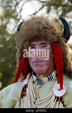 Close-up of Native American man from the Sioux Nation dressed in traditional regalia, pony bead necklace and bison - Stock Photo