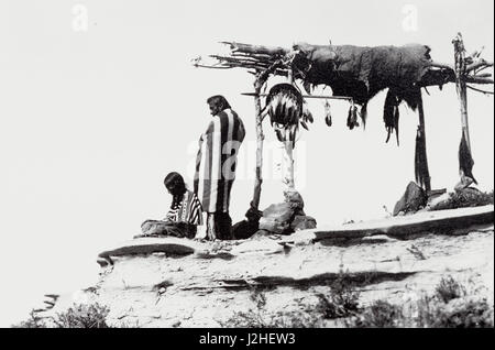 1912 Historic photograph of the Blackfeet Indians called Tribute to the Dead by Roland Reed of an Indian funeral - Stock Photo