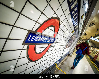 Leicester Square tube station logo on station wall, London, UK. - Stock Photo