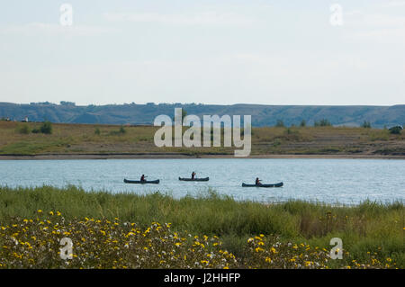 Canoe races on Lake Sakakawea are part of the Fort Berthold warriors race which keeps tribal members in top physical - Stock Photo