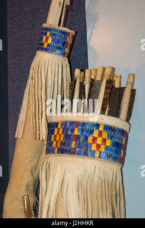 Mandan quiver and bow decorated with leather and porcupine quillwork on display at the On-A-Slant Indian Village - Stock Photo