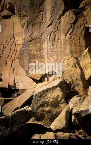 Freemont petroglyph rock art on canyon panel known as 'The Three Kings' on the McConkie Ranch up Dry Forks of Nine - Stock Photo