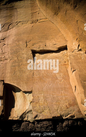 Freemont petroglyph rock art of humans on canyon panel on the McConkie Ranch up Dry Forks of Nine Mile Canyon, Utah - Stock Photo