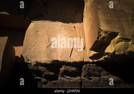Freemont petroglyph rock art of a human deity on canyon panel on the McConkie Ranch up Dry Forks of Nine Mile Canyon, - Stock Photo