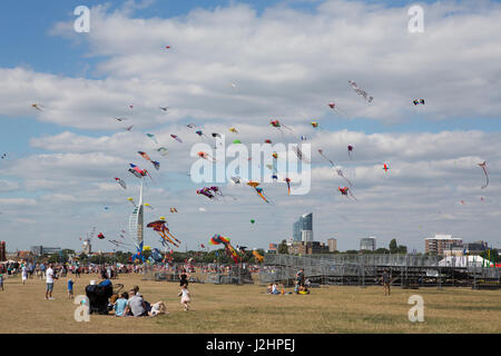 Colourful kites filling the sky at the annual kite festival on Southsea common in Portsmouth Hampshire. - Stock Photo