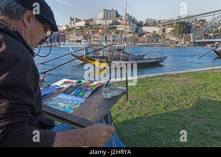 Painter in front of Rabelo boats, port wine boats on the Rio Douro, Douro River, Porto, Portugal, Germany - Stock Photo