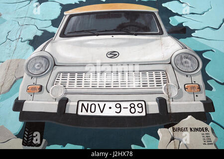 Graffiti representing the Trabant,the most popular car in East Germany,in the famous section of Berlin Wall (berliner - Stock Photo