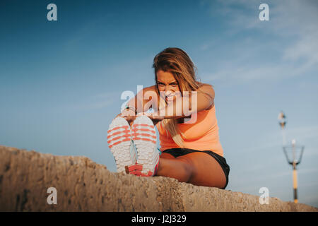 woman stretching her legs after a workout stock photo  alamy